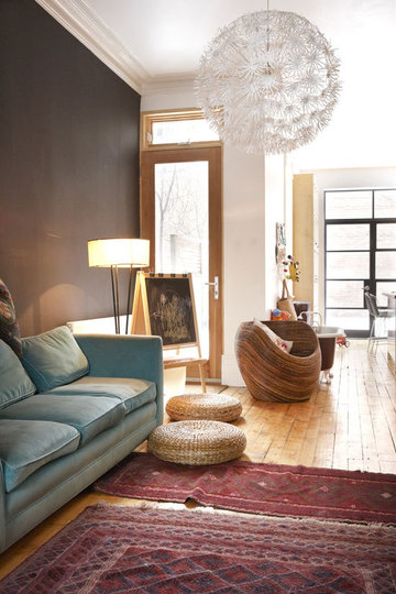 modern setting with a complementary colored sofa again i love the robins egg with the darker red rugs especially